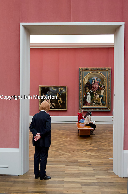 Visitors looking at old masters paintings at Gemaldegalerie at Kulturforum in Berlin Germany