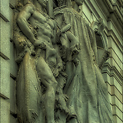 Decorative and ornamental stonework and sculptures on the  Surrogate Court building, in NYC. <br /> <br /> The Surrogate's Courthouse, also known as the Hall of Records, is a Beaux Arts municipal building in lower Manhattan in New York City.<br /> <br /> The Beaux Arts exterior features fifty-four sculptures artists Philip Martiny and Henry Kirke Bush-Brown, representing both allegorical figures &mdash; such as New York in Its Infancy, New York in Revolutionary Times, Philosophy, Law, and the seasons &mdash; and eminent figures from the city's past, and eminent figures from the city's past, including Peter Stuyvesant, DeWitt Clinton, David Pietersen De Vries, and mayors Caleb Heathcote, Abram Stevens Hewitt, Philip Hone, Cadwallader David Colden and James Duane.<br /> <br /> The Surrogate's Courthouse is both US National Historic Landmark and NYC Landmark
