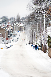 Church Street Ecclesfield Sheffield, people choose to walk rather than take their cars through the most widespread Snows to hit Britain for 20 years.1st December 2010.Images © Paul David Drabble
