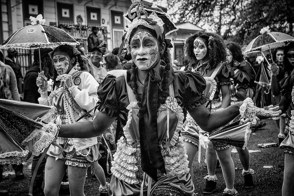 A member of the New Orleans Baby Doll Ladies poses in the Zulu Social Aid & Pleasure Club's 'Zulu Parade' on Jackson Avenue, the first parade on the morning of Mardi Gras Day on February 12, 2013 in New Orleans, Louisiana.