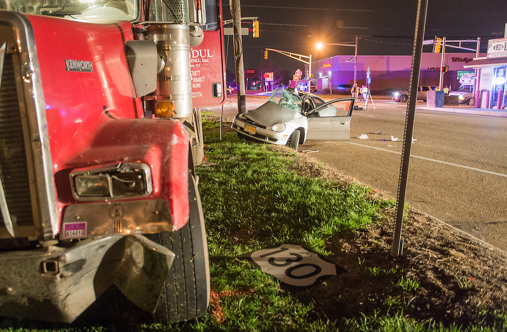 Police investigate the scene of an early morning accident that injured two motorist on US Rt 130 at NJ Rt 541 in Burlington, NJ, Monday, April 13, 2015.  Police say that the car, traveling on Rt 541 collided with the northbound dump truck traveling on Rt 130 shortly before 4:30am.  The driver of the car, a 28 year old man from Bridgeton, NJ, was flown to a regional trauma center with serious injuries.  The condition of the dump truck driver was not available at the scene.  Police from Burlington City and Burlington Township continued their investigation for several hours. Northbound US Rt 130 was closed for several hours.  (Bryan Woolston / For the Burlington County Times).