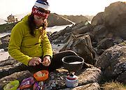 Cooking dinner on bike tour of the Lofoten Islands in Northern Norway.