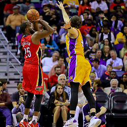 Apr 8, 2016; New Orleans, LA, USA; New Orleans Pelicans guard Jordan Hamilton (25) shoots over Los Angeles Lakers forward Ryan Kelly (4) during the second quarter of a game at the Smoothie King Center. Mandatory Credit: Derick E. Hingle-USA TODAY Sports