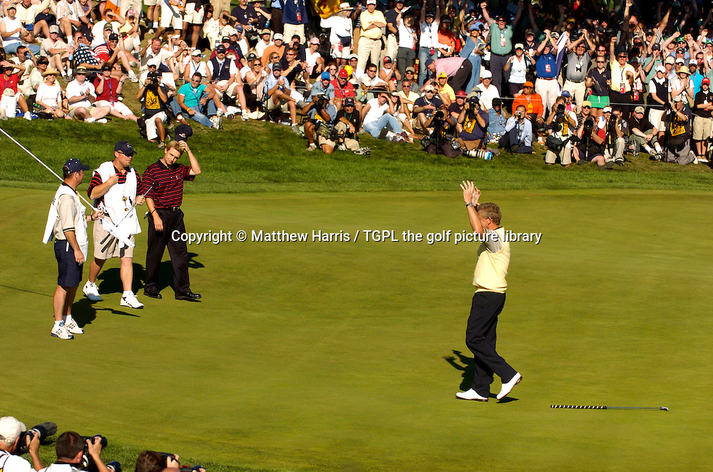 Ryder Cup hero Colin MONTGOMERIE (EUR)  sinks the winning point at 18th V David TOMS (USA) during final day Singles of the Ryder Cup Matches 2004,Oakland Hills (South Course),Bloomfield,Michigan,USA.