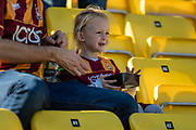 A young Bradford City fan looks worried as her team go 1-0 down in the first half during the EFL Sky Bet League 2 match between Bradford City and Carlisle United at the Utilita Energy Stadium, Bradford, England on 21 September 2019.