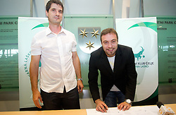 Sports director Roman Pungartnik and Handball goalkeeper Dejan Peric at press conference when he signs a contract with RK Celje Lasko, on May 27, 2011 in Arena Zlatorog, Celje, Slovenia.  (Photo By Vid Ponikvar / Sportida.com)