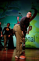 Nederland. Rotterdam, 17 juni 2004.<br /> 35e Poetry International Festival. World Slampionships 2004. Poetry Slam.<br /> Buddy Wakefield uit de Verenigde Staten, de winnaarposeert met zijn rood-wit-blauwe winnaarsband om zijn middel <br /> Foto Martijn Beekman<br /> niet voor trouw,ad,parool en nrc