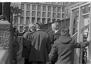 05/04/1978.04/05/1978.5th April 1978.Photograph of Duncan Stuart, (left) Lecturer in Architecture, College of Technology, Bolton St., Dublin, remains within the barriers of the partly demolished building in Molesworth St., while Mr Noel Murphy, Executive, Merchant Bank Ltd., on behalf of the developers, the Gallagher Group, makes an effort to persuade the students engaged in the sit-in to leave the building.Outside, building workers paraded in protest at being removed from the site.
