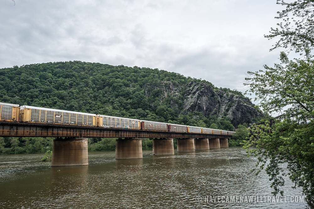 A freight train moves across a bridge over the Potomac in Harpers Ferry, West Virginia.