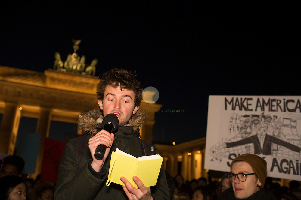 BERLIN, Brandenburg Gate, 12.11.2016 / Hundreds of people, among them many Americans, gathered in the center of the German capital to protest against President-elect Donald Trump.<br /> <br /> About 700 protesters followed a Facebook initiative to rally at the Brandenburg Gate, next to the U.S. Embassy. At this peaceful event, everyone was invited to speak out against Trump and to describe the expectations in the 45th president of the United States. Many spoke about the fear of growing discriminations against minorities, or simply read poetry.
