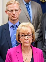 © Licensed to London News Pictures. 11/07/2016. London, UK. Conservative party leadership contender ANDREA LEADSOM MP stands in front of her husband BEN LEADSOM (top) as she delivers a statement in Westminster  In which she pulled out of the leadership race.  Photo credit: Ben Cawthra/LNP