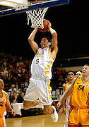 Troy McLean slam dunks the ball during the NBL basketball match between the Wellington Saints and the Mighty Hawks, 14 April, 2002 at the Wellington Event Centre. Photo: PHOTOSPORT<br /><br /><br /><br />046433 *** Local Caption ***