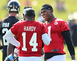 July 27, 2017 - Flowery Branch, GA, USA - Atlanta Falcons wide receivers Julio Jones and Justin Hardy share a laugh during the first day of team practice at training camp on Thursday, July 27, 2017, in Flowery Branch, Ga. (Credit Image: © Curtis Compton/TNS via ZUMA Wire)