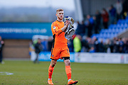 AFC Wimbledon goalkeeper George Long (1), on loan from Sheffield United, applauds the visiting fans after the EFL Sky Bet League 1 match between Shrewsbury Town and AFC Wimbledon at Greenhous Meadow, Shrewsbury, England on 24 March 2018. Picture by Simon Davies.