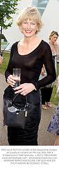 MISS JULIA PEYTON-JONES of the Serpentine Gallery, at a party in London on 9th July 2002.PBX 4