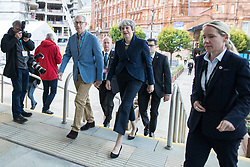 © Licensed to London News Pictures . 02/10/2017. Manchester, UK. Prime Minister THERESA MAY and husband PHILIP MAY enter the conference hall at the start of the second day of the Conservative Party Conference at the Manchester Central Convention Centre . Photo credit: Joel Goodman/LNP
