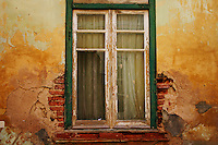 Old window, decaying plaster wall, Tavira Portugal