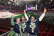 Feb 1, 2015; Glendale, AZ, USA; Seattle Seahawks fans pose for a photo before Super Bowl XLIX against the New England Patriots at University of Phoenix Stadium. The Patriots defeated the Seahawks 28-24.