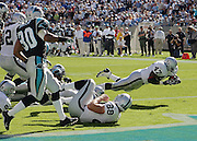 CHARLOTTE, NC - NOVEMBER 7:  Running back Tyrone Wheatley #47 of the Oakland Raiders scores one of his two touchdowns rushing on this play against the Carolina Panthers at Bank of America Stadium on November 7, 2004 in Charlotte, North Carolina. The Raiders defeated the Panthers 27-24. ©Paul Anthony Spinelli  *** Local Caption *** Tyrone Wheatley
