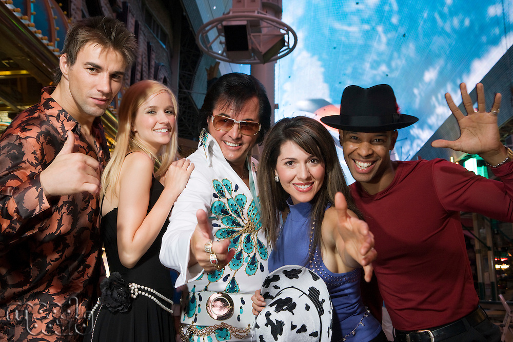 Portrait of group of friends and Elvis impersonator