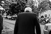 Democratic presidential candidate, Sen. Bernie Sanders, I-Vt heads to greet supporters after holding a press conference out front of his home in Burlington, VT, Sunday, June 12, 2016. (AP Photo/Cheryl Senter)