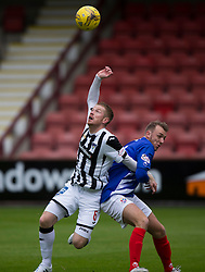 Dunfermline's Andy Geggan and Cowdenbeath's Greig Spence. Half time : Dunfermline 0 v 0 Cowdenbeath, Scottish League Cup game played today at East End Park.