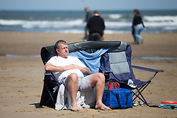 © Licensed to London News Pictures. 05/06/2016. Scarborough UK. A man sleeps in the sun at Scarborough beach on another sunny day in Yorkshire. Photo credit: Andrew McCaren/LNP