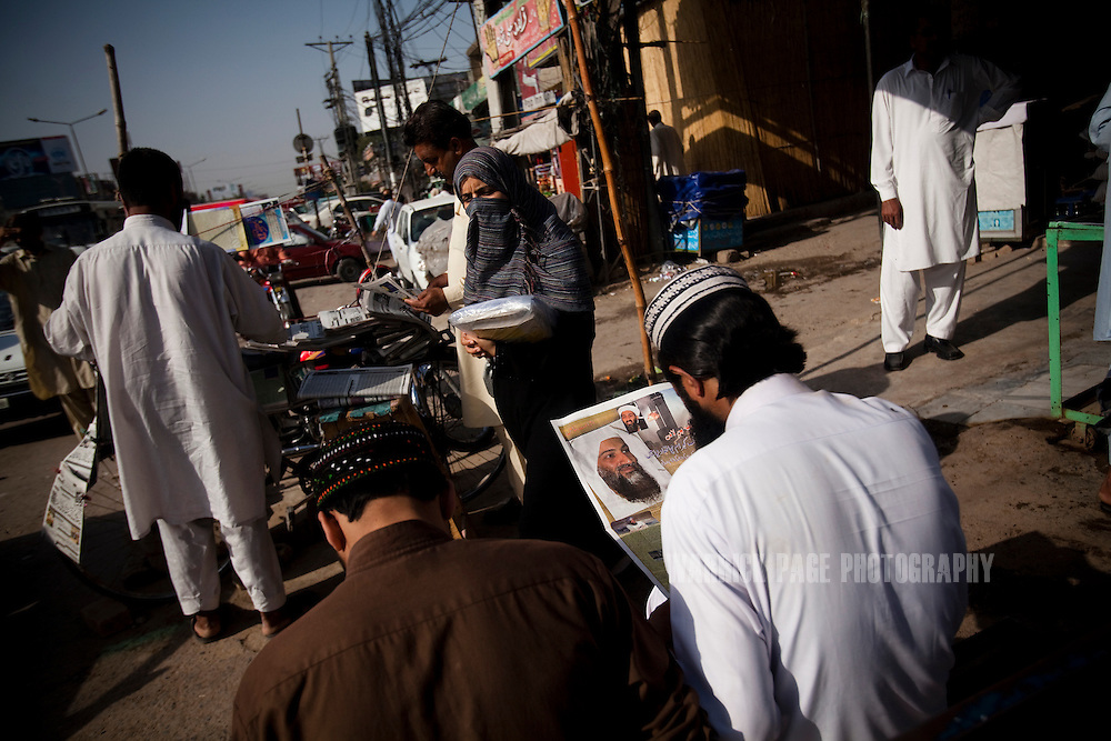 Commuters read the morning newspapers announcing the death of Osama Bin Laden, on May 3, 2011, in Rawalpindi, Pakistan. The operation, code-named Operation Neptune Spear, was launched from neighbouring Afghanistan by Seal Team Six. U.S. forces took bin Laden's body to Afghanistan for identification, then dumped it the Arabian Sea. Pakistan has since been widely suspected as having prior knowledge of his whereabouts as the compound was less than a kilometre from the country's biggest military academy. Osama bin Laden was allegedly responsible for supporting the bombing of the US Embassy in Nairobi, Kenya, the attack on the USS Cole and the suicidal attacks of September 11, 2001 in the US. (Photo by Warrick Page)