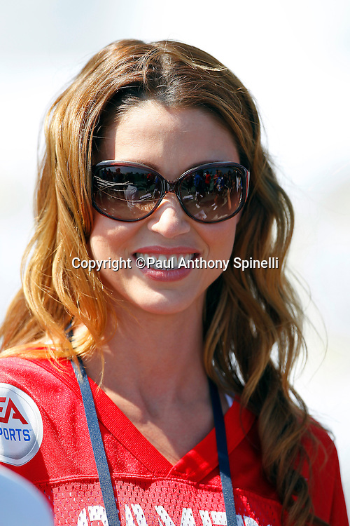 Actress Shannon Elizabeth (09) of the Gamers team smiles while playing flag football in the EA Sports Madden NFL 11 Launch celebrity and NFL player flag football game held at Malibu Bluffs State Park on July 22, 2010 in Malibu, California. (©Paul Anthony Spinelli)