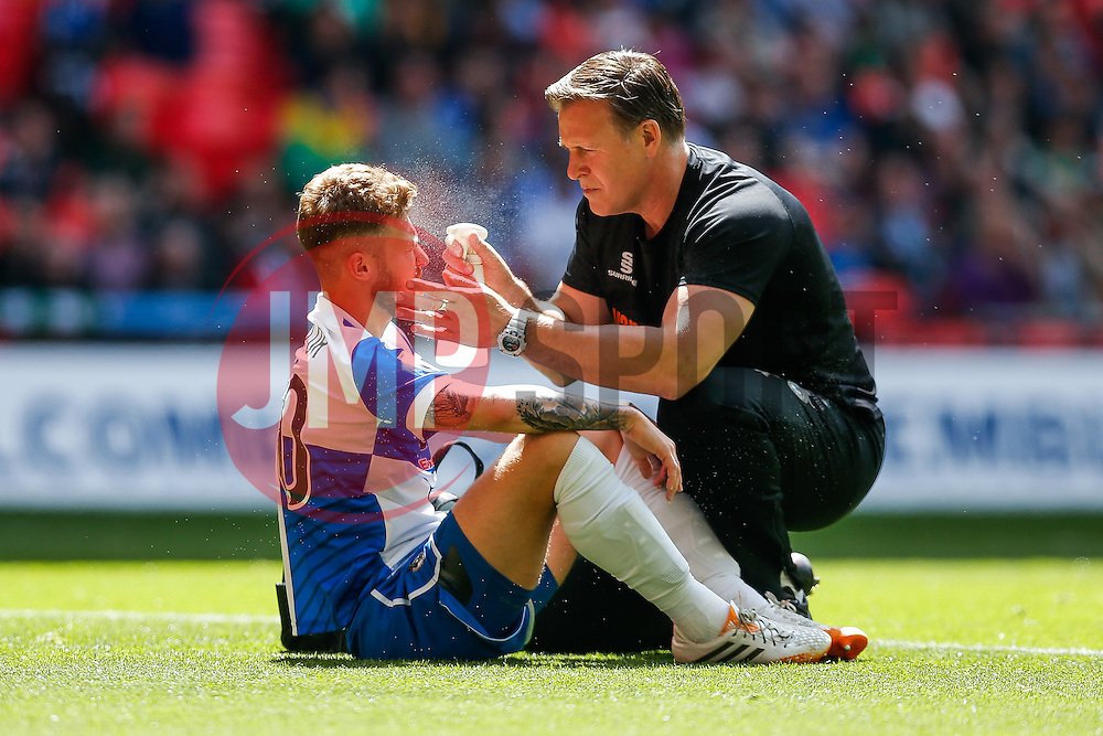 Matt Taylor of Bristol Rovers is sprayed with water by the physio after colliding with James McKeown of Grimsby Town - Photo mandatory by-line: Rogan Thomson/JMP - 07966 386802 - 17/05/2015 - SPORT - FOOTBALL - London, England - Wembley Stadium - Bristol Rovers v Frimsby Town - Vanarama Conference Premier Play-off Final.