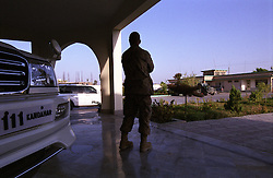 31 August 2005...A US Army Officer stand next to the Governor's car. ..The Gov. Guest's House (this is how the local police call it) is  a massive building with extra suites for guests and a separate house for Haji Asadullah Khalid - the Governor - Army.