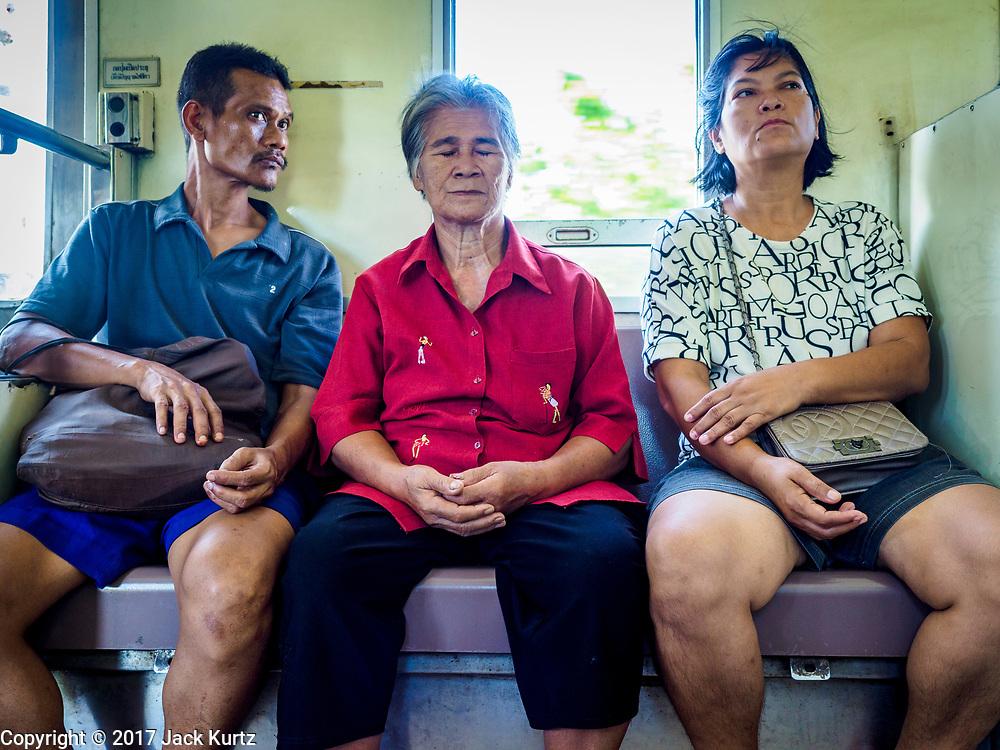 02 JUNE 2017 - BANGKOK, THAILAND: People ride the morning train from Wong Wian Yai train station in Thonburi to Samut Sakhon.       PHOTO BY JACK KURTZ