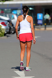 Newlywed Melanie Sykes looking mighty tanned wearing a white vest top and a pair of red shorts out shopping at Sainsbury's. The very toned TV presenter had no problem pushing a full trolley load of shopping and off loading the bags in the boot of her car... London, UK. 04/06/2013<br />BYLINE MUST READ : JAMESY/GOTCHA IMAGES<br /><br />Copyright by © Gotcha Images Ltd. All rights reserved.<br />Usage of this image is conditional upon the acceptance <br />of Gotcha Images Ltd, terms and conditions available at<br />www.gotchaimages.com