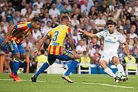 Real Madrid's Marco Asensio and Valencia's Jeison Murillo and Ruben Vezo during La Liga match between Real Madrid and Valencia CF at Santiago Bernabeu Stadium in Madrid, Spain August 27, 2017. (ALTERPHOTOS/Borja B.Hojas)