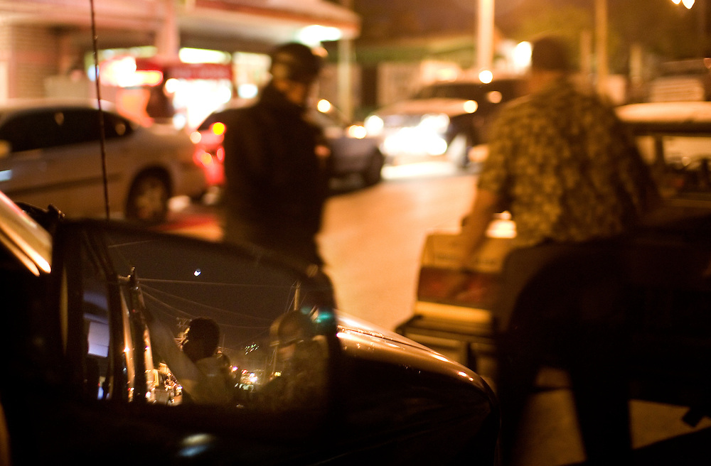 Mexican Federal Police searching people and cars for drugs in Juarez, Saturday, March 28, 2009.