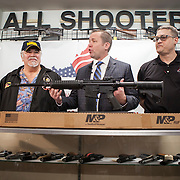 Corey Stewart, center, Chairman of the Board of Supervisors of Prince William County and Virginia Gubernatorial candidate, gave away a Smith & Wesson M&P 15 Sport II, an AR-15 rifle, to Rick Thompson, left, at All Shooters Tactical in Woodbridge, Virginia on Wednesday, January 11, 2017.  The Stewart campaign used the AR-15 giveaway as an opportuntiy to tout Stewart's record on support for the second amendment.  John Boal Photography