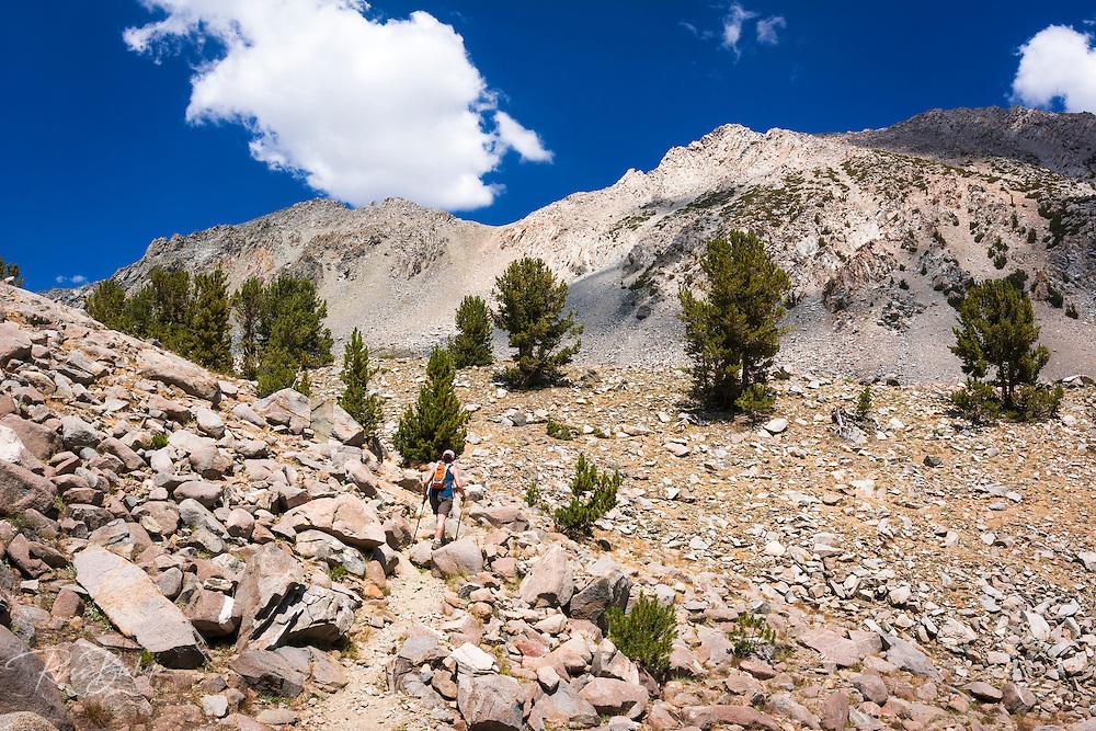 Hiker on the upper Big Pine Lakes Trail, John Muir Wilderness, Sierra Nevada Mountains, California USA