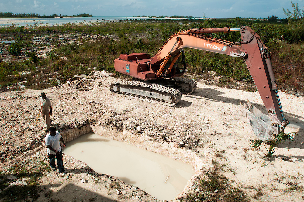Men at a construction site in a mangrove area. The site will become a restaurant, night club and small hotel.