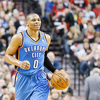 04 December 2013: Oklahoma City Thunder point guard Russell Westbrook (0) brings the ball upcourt during the Portland Trail Blazers 111-104 victory over the Oklahoma City Thunder at the Moda Center, Portland, Oregon, USA.