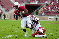 October 23, 2010; Stanford, CA, USA;  Stanford Cardinal running back Tyler Gaffney (25) breaks a tackle from Washington State Cougars linebacker Alex Hoffman-Ellis (17) during the second quarter at Stanford Stadium.
