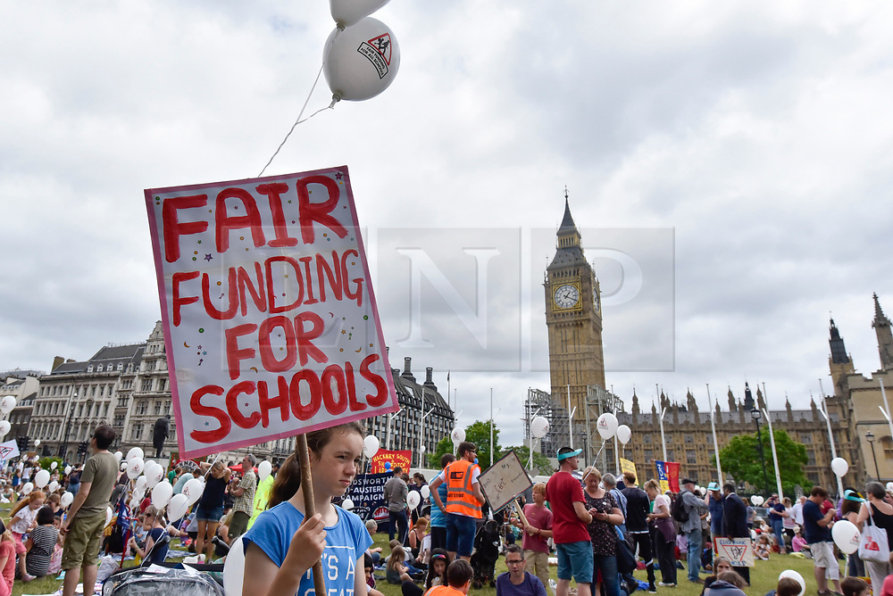 """© Licensed to London News Pictures. 16/07/2017. London, UK. Parents, pupils and teachers gather for an event called """"Carnival Against The Cuts"""" in Parliament Square.  The demonstration, organised by Fair Funding For Schools, a parent led campaign, calls for the government to increase funding for schools.   Photo credit : Stephen Chung/LNP"""