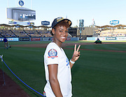 Jun 13, 2018; Los Angeles, CA, USA; Deanna Hill  poses before a MLB game between the Texas Rangers and the Los Angeles Dodgers at Dodger Stadium. Constantine ran the third  leg of the Southern California Trojans women's 4 x 400m relay team that won the NCAA title to clinch the national team championship.
