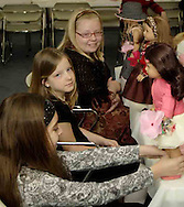 (front to back) Julie Slyby, 10; Krysten Haas, 10 and Elizabeth Dauhtery, 10 and their dolls at the American Girl Tea Party, Saturday, January 27, 2007 in Waynesville's Mary L. Cook Library.