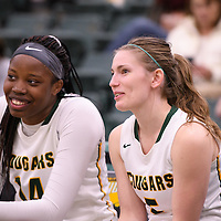 4th year guard Caitlin Zacharias (5) and 1st year post Angela Bongomin (14) of the Regina Cougars in action during the home game on December  2 at Centre for Kinesiology, Health and Sport. Credit: Arthur Ward/Arthur Images