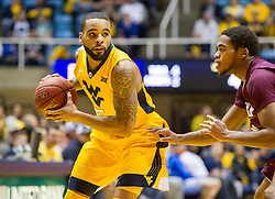 Dec 21, 2015; Morgantown, WV, USA; West Virginia Mountaineers guard Jaysean Paige (5) looks to pass during the first half against the Eastern Kentucky Colonels at the WVU Coliseum. Mandatory Credit: Ben Queen-USA TODAY Sports