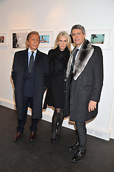 Left to right, Designer VALENTINO GARAVANI, CHARLENE de GANAY and CARLOS SOUZA at a private view of photographs by Anthony Souza held at The Little Black Gallery, 13A Park Walk, London SW10 on 13th December 2011.