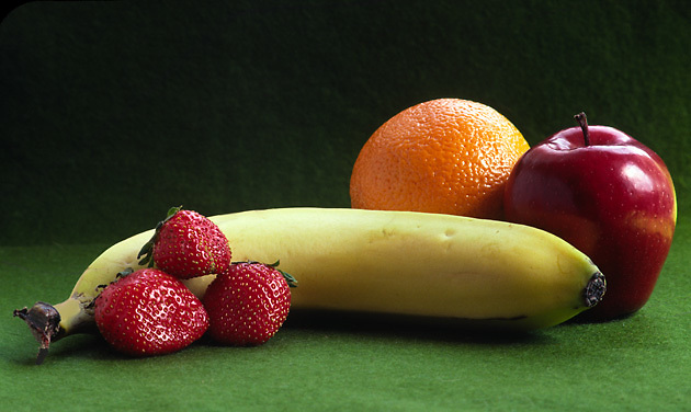 fruit still life; nutritious food; strawberries; banana; apple; orange; colorful; tasty