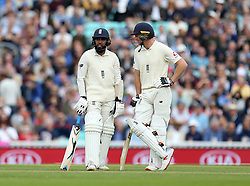 England's Adil Rashid and Jos Buttler await the decision before dismissed for an lbw by India's Jasprit Bumrah (not in picture) during the test match at The Kia Oval, London.