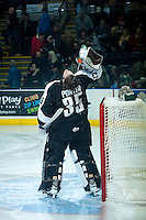 KELOWNA, CANADA - JANUARY 7: Cody Porter #35 of Vancouver Giants wets down his hair before his helmet on against the Kelowna Rockets on January 7, 2015 at Prospera Place in Kelowna, British Columbia, Canada.  (Photo by Marissa Baecker/Shoot the Breeze)  *** Local Caption *** Cody Porter;