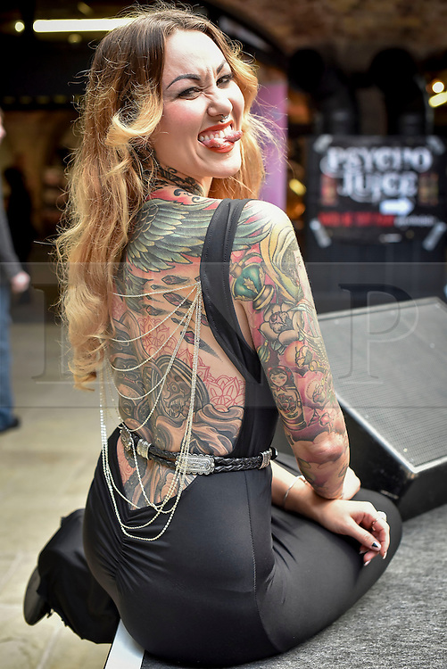 © licensed to London News Pictures. 25/09/2015<br /> The 11th London International Tattoo Convention, one of the most prestigious body art conventions in the world, brought together 400 of the best tattoo artists to thousands of admirers at Tobacco Dock. Other attractions and alternative performances included burlesque, sword swallowing, striptease dancers, fire-dancers and trapeze performers. Pictured Elegy Ellem a sideshow performer.<br /> Photo credit : Ian Whittaker/LNP